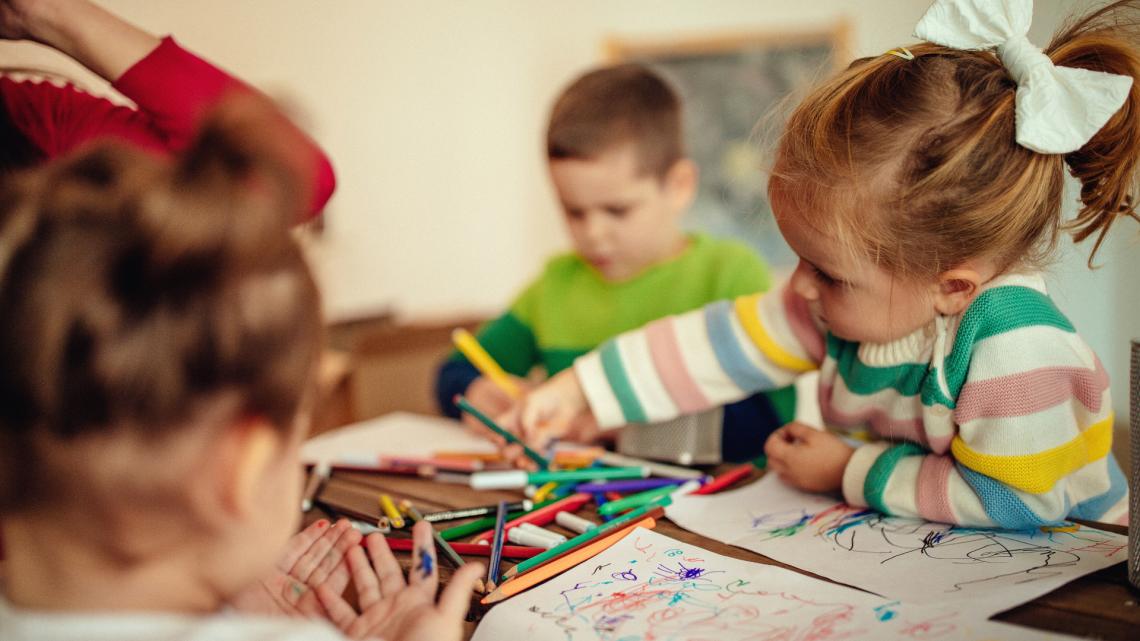 kids drawing at table