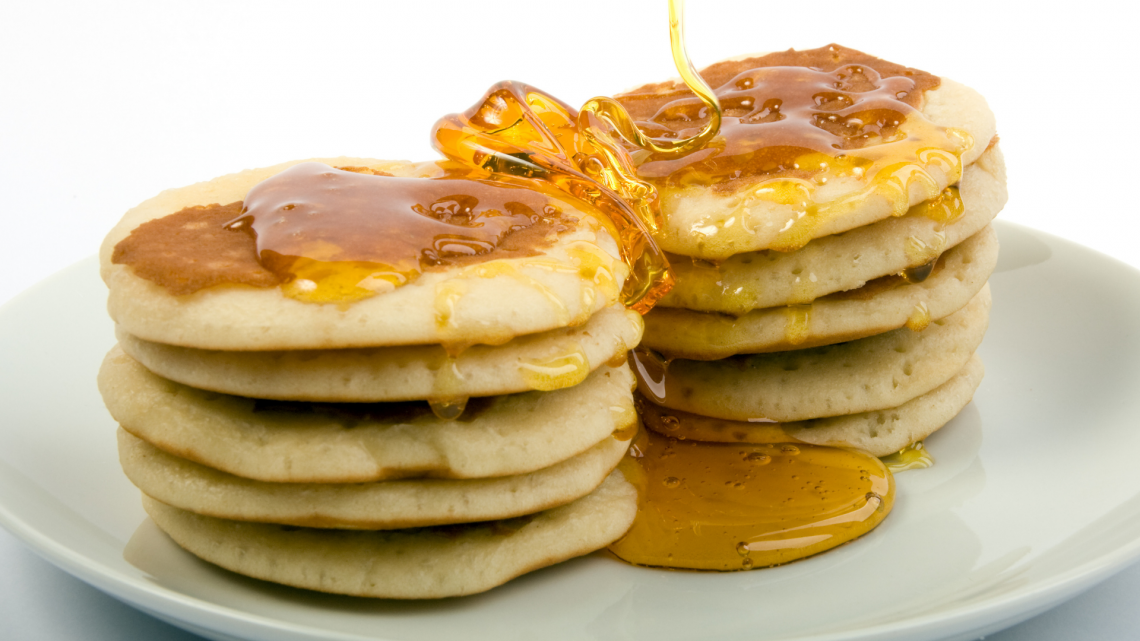 syrup poured on pancakes