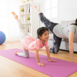 mom and kid doing yoga