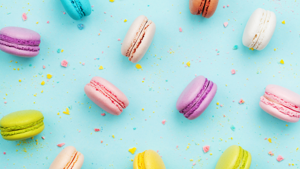 colorful macarons with blue background