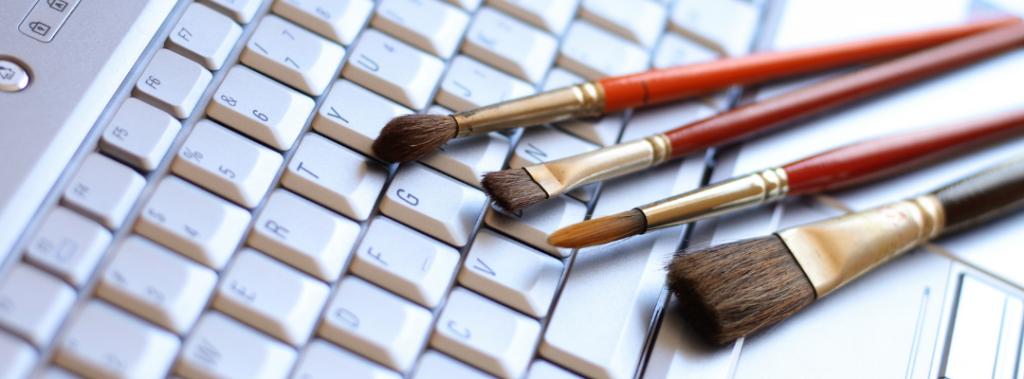 paintbrushes on laptop