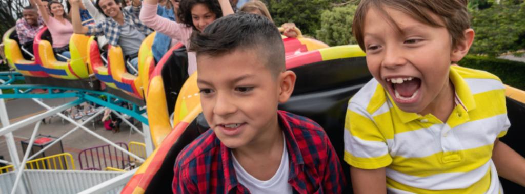 kids on amusement park ride