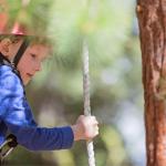 kid on outdoor adventure course