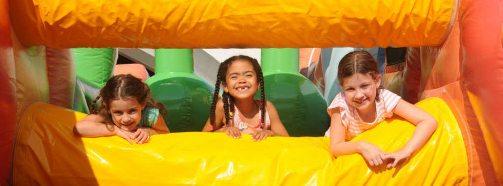 kids on inflatable thing